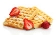 belgium waffles with strawberries isolated on white