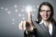 Businesswoman pressing social media icon