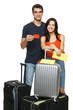 Young fcouple standing with suitcases holding empty credit cards