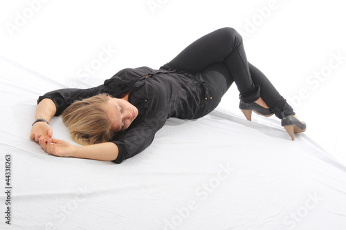 Blonde woman lying on white floor