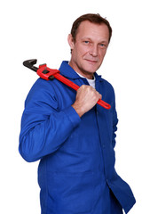 Plumber holding wrench over shoulder