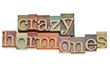 crazy hormones text  in wood type