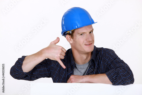 Manual worker making a phone shape with his hand