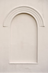 Old aged plastered faux arch false fake window stucco frame back