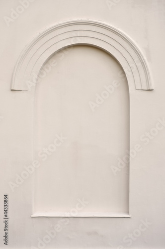 Old aged plastered faux arch false fake window stucco frame back