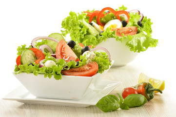 Vegetable salad bowls isolated on white
