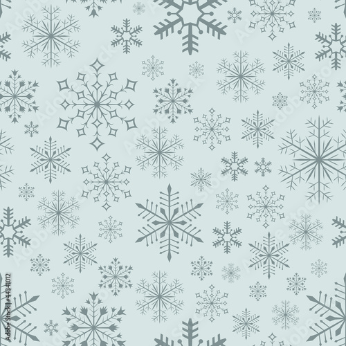 Abstract seamless bluish snowflake background.