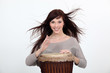 Woman with a djembe drum