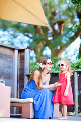 Mother and daughter at outdoor terrace