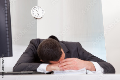 Businessman sleeping at the office