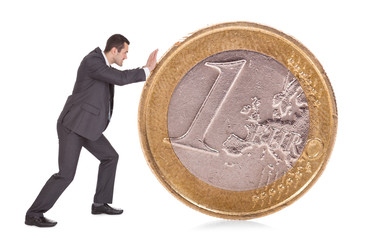 Successful businessman pushing one euro coin