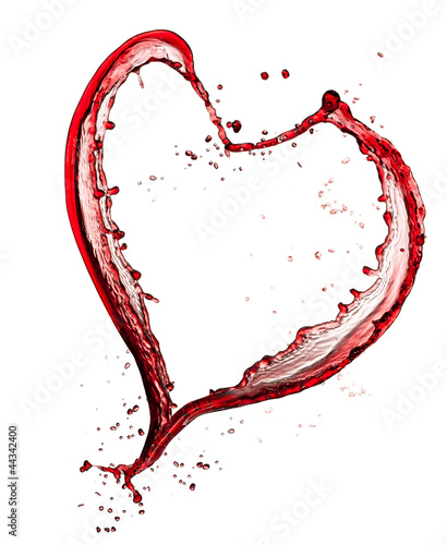 Heart symbol made of red wine, isolated on white background