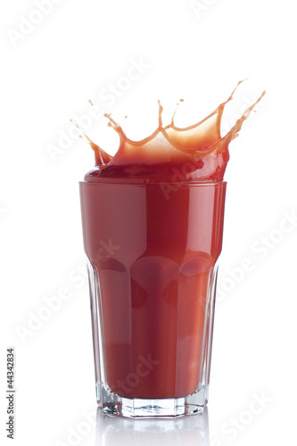 Tomato juice splash in a glass