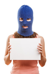 Woman in balaclava holding blank card