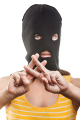 Woman in balaclava showing jail or prison finger gesture
