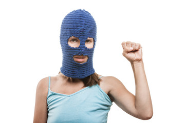 Woman in balaclava showingraised fist gesture