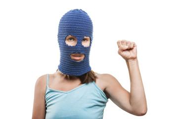 Woman in balaclava showingraised fist gesture
