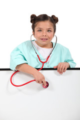 Little girl dressed as nurse
