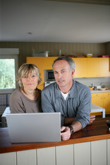 Couple searching for recipes on the Internet