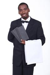 Waiter showing menus