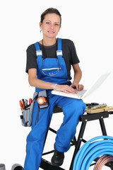 Woman plumber using laptop computer