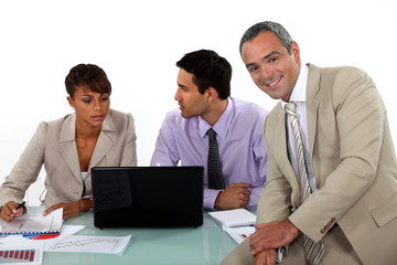 Three business colleagues at a desk