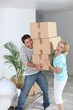 Couple with pile of cardboard