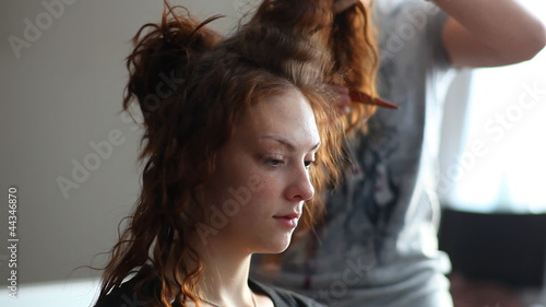 Model visage hairstyle for photography in studio.