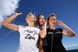 teen girls walking outdoors and listening music