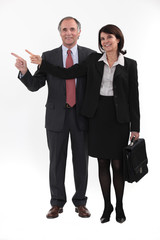 Mature businesspeople standing on white background