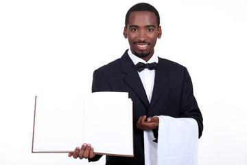 black waiter showing menu
