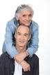 Elderly couple on white background
