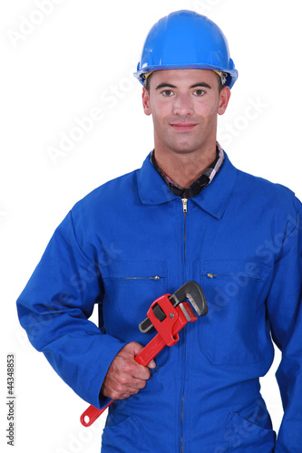 Worker holding red wrench