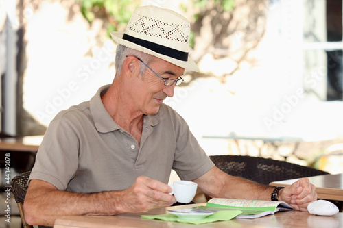 Older man at an alfresco cafe