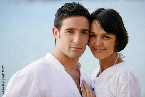 Couple wearing white clothing