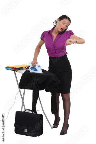 businesswoman in a hurry ironing her suit