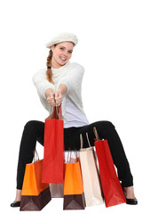 Woman posing with her shopping bags