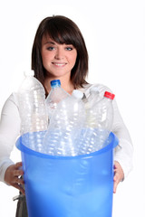 Young woman recycling bottles