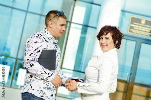 Two partners shaking hands at business meeting