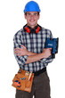 Young tradesman holding a sander