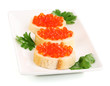 Red caviar on bread on white plate isolated on white