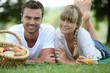 Couple having romantic picnic in a field