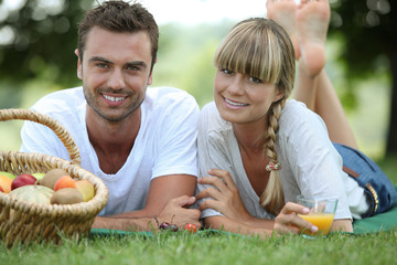 Couple having romantic picnic in a field