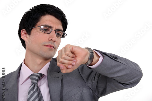 A businessman checking the time,
