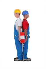 duo of workmen standing back to back isolated on white