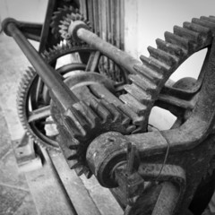 Gears of an old manual rotary printing press