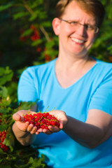 Redcurrant and woman