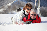 Older couple playing in the snow