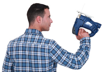 craftsman holding an electric drill