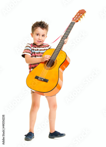 Little boy plays acoustic guitar